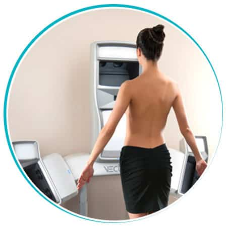 Woman standing in front of scanning equipment.